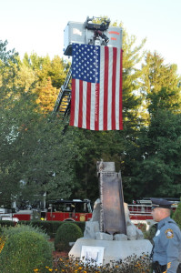 The American Flag is draped over the memorial from Newton's Tower Truck. Photo by Jennifer Jean Miller.