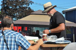 One of the griller prepares something special for hungry event-goers. Photo by Jennifer Jean Miller.