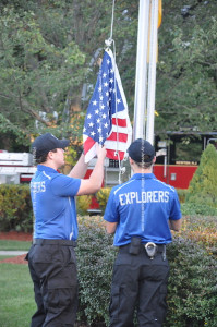 Police Explorers raise the flag. Photo by Jennifer Jean Miller.