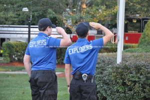 Police explorers salute the flag. Photo by Jennifer Jean Miller.