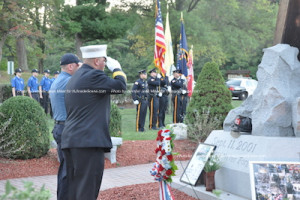 Saluting the wreath. Photo by Jennifer Jean Miller.