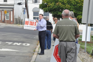 David Larsen, Candidate for the Dist. 7 Congressional Seat, holds up a sign at the rally. Photo by Jennifer Jean Miller.