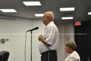 Residents Richard Heckman and Margaret Cosmos, ask questions during the meeting. Photo by Jennifer Jean Miller.