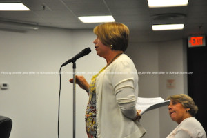 Sara Megletti of PB&J Stores speaks to the council about parking near Spring Street. Photo by Jennifer Jean Miller.
