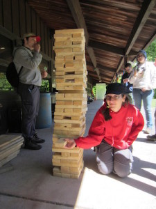 Crew Vice President of Administration Katie Rozek playing giant Jenga. Image courtesy of Venturing Crew 276.