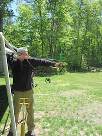 Crew Advisor Andrew Joiner at the archery range. Image courtesy of Venturing Crew 276.