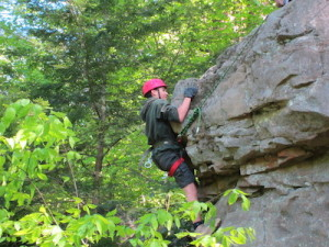 Crew Vice President of Public Relations Stephen Rozek climbing the rock wall. Image courtesy of Venturing Crew 276.