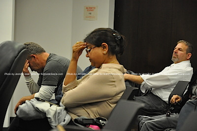 Mittal Patel of MNA Realty, along with her builder, both hold their heads as neither vote carries to permit her Taco Bell in Newton. Photo by Jennifer Jean Miller.