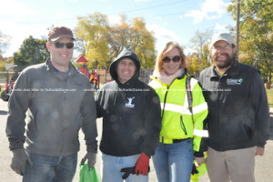 Mayor Dan Flynn (far left) poses with others who volunteered their time, including (from left to right) Anwar Quarmout, Recreation Supervisor Debbie Danielson, and Eric Olsen. Photo by Jennifer Jean Miller.
