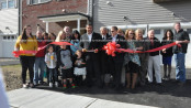 Greg Martorana cuts the ribbon to open the Grande Villaggio property. Photo by Jennifer Jean Miller.