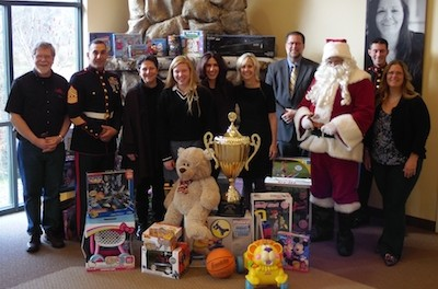 Left to right: Don Hall, The Chatterbox Drive-In; First Sergeant Christopher Piazza, United States Marine Corps; Project Self-Sufficiency Board of Directors President Beverly Gordon; Project Toys 4 Teens Coordinator Ruby Esposito; Season of Hope Toy Drive Co-Chairperson and Project Self-Sufficiency Board of Directors member Sue Murphy; Pass it Along Executive Director Diane Taylor; Newton School District Superintendent Dr. Ken Greene; Santa Claus (aka, Sussex County Freeholder George Graham); Gunnery Sergeant Matthew Hutcheson, United States Marine Corps; and Sandra Zaruba, Project Self-Sufficiency participant and Season of Hope toy shopper. Image courtesy of Project Self-Sufficiency.