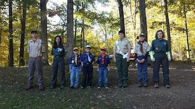 from left to right) Scout, Katie R., three cub scouts, Alex M., and Emily B. Image courtesy of Venture Crew 276.