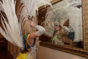 Bianca Silva adjusts her headdress. Photo provided.