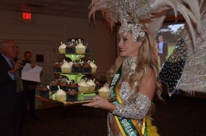 Bianca Silva carries cupcakes at the event while in costume. Photo provided.