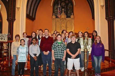 The members of the Children's Chorus of Sussex County are joined by Dr. Jason Bishop of Drew University for a rehearsal of Benjamin Britten's Saint Nicolas. (Photo credit: Melanie Vanni).