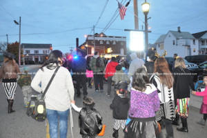 The Newton Halloween Parade makes its way along up to Spring Street. Photo by Jennifer Jean Miller.