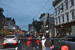 Dusk falls on the Town of Newton as people march through the streets in costume. Photo by Jennifer Jean Miller.