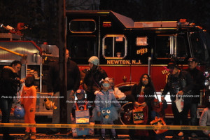 Attendees by one of the firetrucks at the Newton Halloween Parade. Photo by Jennifer Jean Miller.