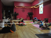 Guests at PEARLL Yoga's anniversary event take in a yoga class. Photo by Jennifer Jean Miller.