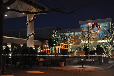 People mill around the hospital entrance to hear holiday music. Photo by Jennifer Jean Miller.
