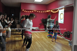 Coin belts jingled and hips swayed during the belly dancing event at PEARLL Yoga's anniversary celebration. Photo by Jennifer Jean Miller.