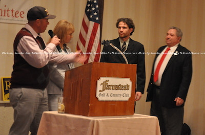 Parker Space (left) addresses the crowd at the podium with running mate Gail Phoebus (second from left) and Sussex County Freeholder Candidates Jonathan Rose (second from right) and Carl Lazzaro (right). Photo by Jennifer Jean Miller.