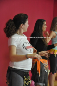 Keri Marino, owner of PEARLL Yoga for the Soul, participates in the belly dancing class during the open house. Photo by Jennifer Jean Miller.