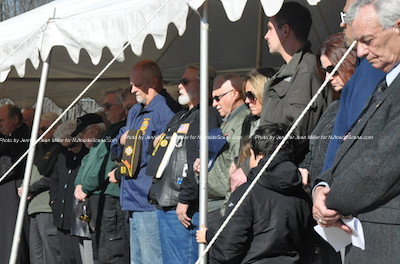 During the prayer for the dedication of the cemetery. John Harrigan (far right) was the person who spearheaded the project. Photo by Jennifer Jean Miller.