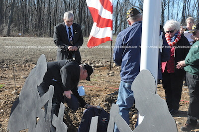 A uniform is first placed down in the plot by the flagpole. Photo by Jennifer Jean Miller.