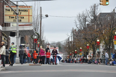 The crowd eagerly awaits the parade procession. Photo by Jennifer Jean Miller.