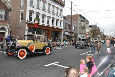 Vintage autos make their way down Spring Street. Photo by Jennifer Jean Miller.