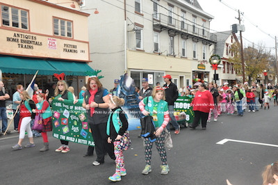 Girl Scouts attired in holiday pajamas march in the parade. Photo by Jennifer Jean Miller.
