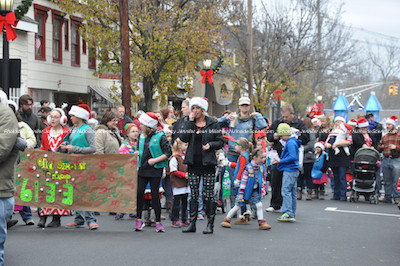 Girl Scouts and a castle float on Spring Street. Photo by Jennifer Jean Miller.