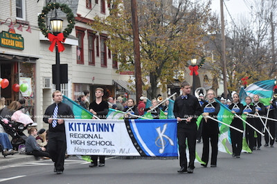 Kittatinny Regional High School Marching Band twirling flags and playing festive songs as they make their way through the crowd. Photo by Jennifer Jean Miller.