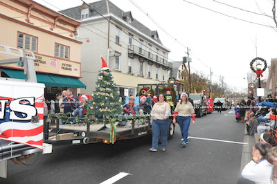 A float with a Christmas Tree as its focal point in the parade. Photo by Jennifer Jean Miller.