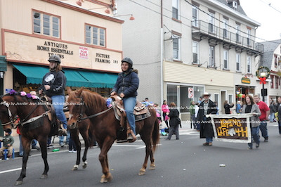 Horses trot down Spring Street. Photo by Jennifer Jean Miller.