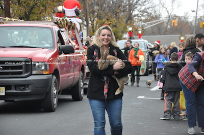 An immense rabbit carried along the parade route. Photo by Jennifer Jean Miller.