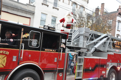 Santa before he makes his second pass on Spring Street and meets children who attended the parade. Photo by Jennifer Jean Miller.