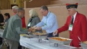 Commissioner Harold J. Wirths of the New Jersey Department of Labor serving a hot lunch to homeless veterans and volunteers at the Stand Down in Morristown. Image courtesy of the Department of Labor.