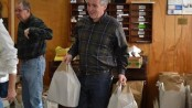 Commissioner Harold J. Wirths of the New Jersey Department of Labor and Workforce Development helps volunteers at the Sussex United Methodist Church organize and bag complete Thanksgiving dinners to be distributed to needy families throughout Sussex County. Image provided.