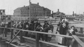 Immigrants entering Ellis Island in 1902. Public domain image.