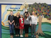 Green Hills Schools Student Council Faculty Advisor Beth Voris (second from left) with Student Council officers Ryan Rittie, Jocelyn Mull, Isobel Costello and Bridget Fajvin with the Stuff the Stocking trophy. Image courtesy of Project Self-Sufficiency.