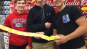 Anthony Esposito, Jack Varian and Troy DuPont, Byram, participating in Sticker Shock at Shop Rite Liquors in Byram. Image provided.