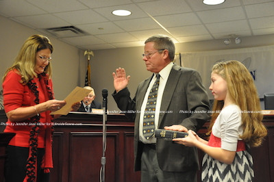 Councilman Gilbert Snyder is sworn in as granddaughter Mikayla Snyder holds the Bible. His wife Cindy and daughter-in-law Sara were also present. Photo by Jennifer Jean Miller.