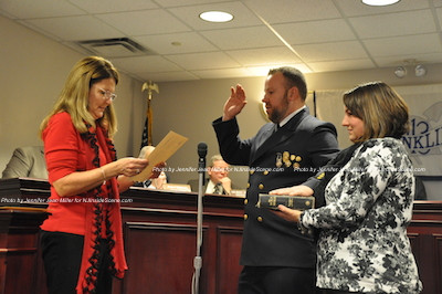 Chief Freddie Babcock takes his oath of office as his wife Michelle holds the Bible. Photo by Jennifer Jean Miller.