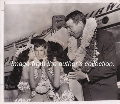 "Joe DiMaggio traveling with his son Joe Jr. aka ""Joey"" in 1953. Photo from the author's collection."