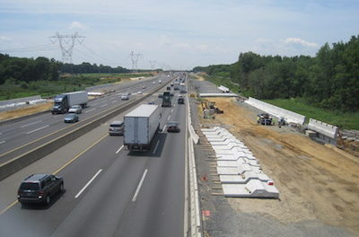 Motorists travel along a stretch of the New Jersey Turnpike. Creative commons image.