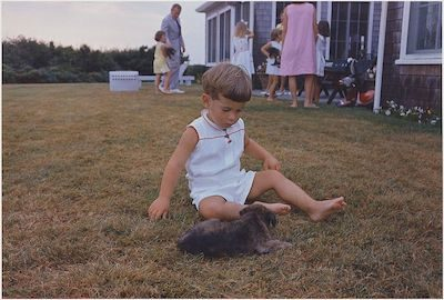 John F. Kennedy Jr. on Aug. 3, 1963 in Hyannisport with a puppy. NARA public domain image.