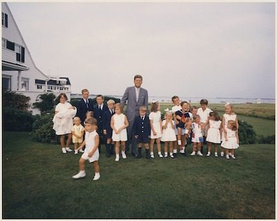 JFK and family pose for a photo during a family weekend in Hyannisport, 1963. Public domain photo by NARA.