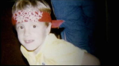 Welles Crowther sporting a red bandana as a child. You Tube screenshot fair use image.